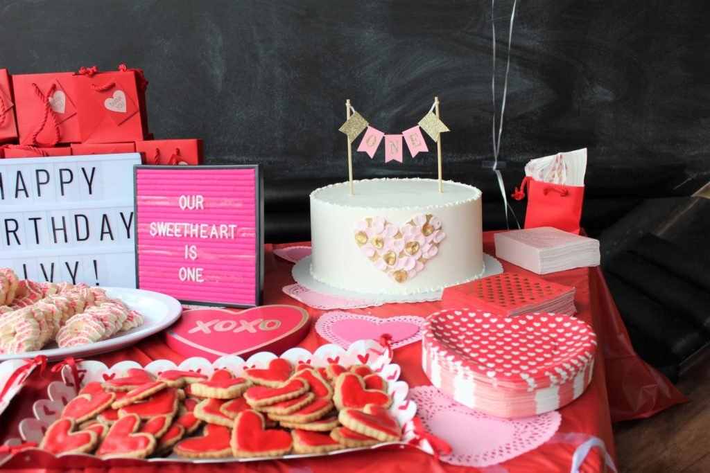 Our Sweetheart Is One Valentine S First Birthday Party Theme Red And Pink Hearts Birthday Weheartbeauty 23 We Heart Beauty